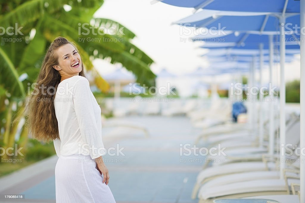 Portrait of smiling young woman on vacation royalty-free stock photo