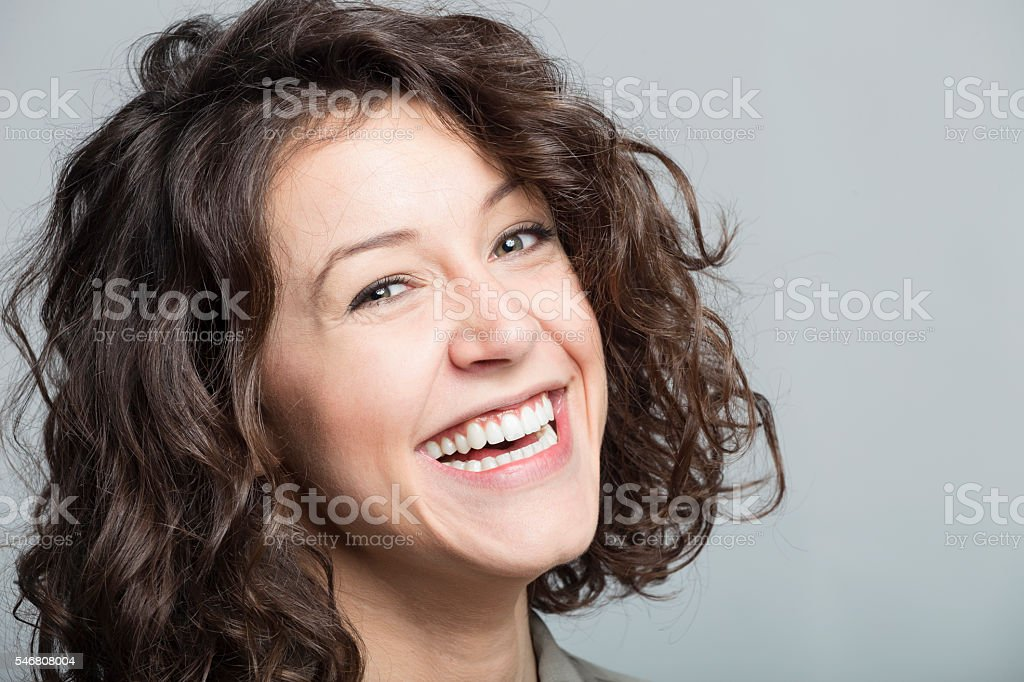 Portrait of smiling young woman stock photo