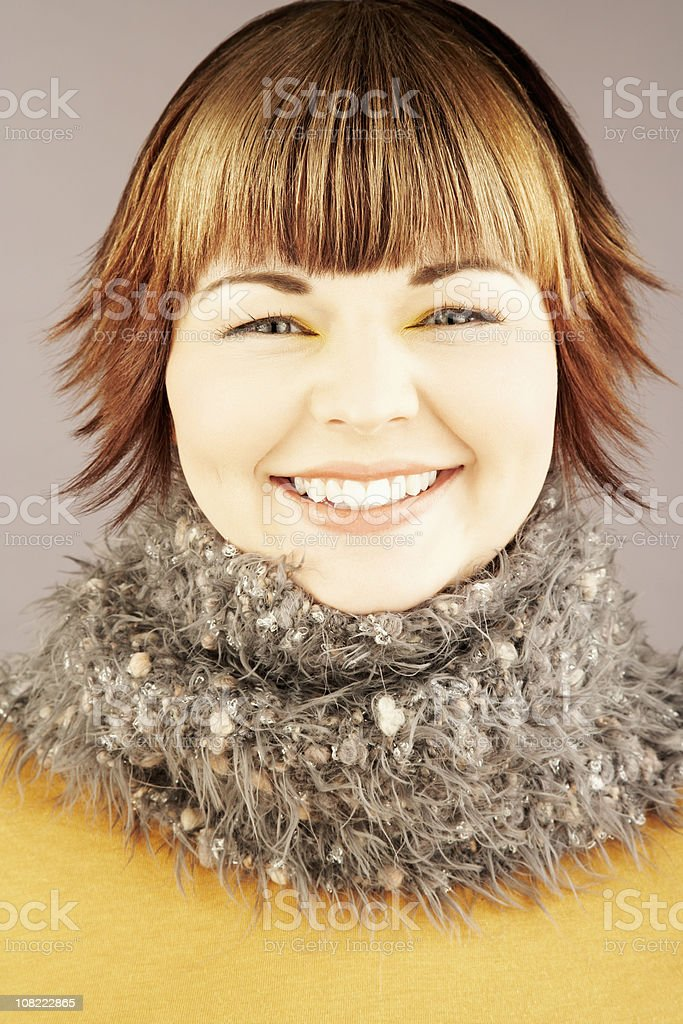 Portrait of Smilling Young Woman Wearing Cozy Scarf royalty-free stock photo