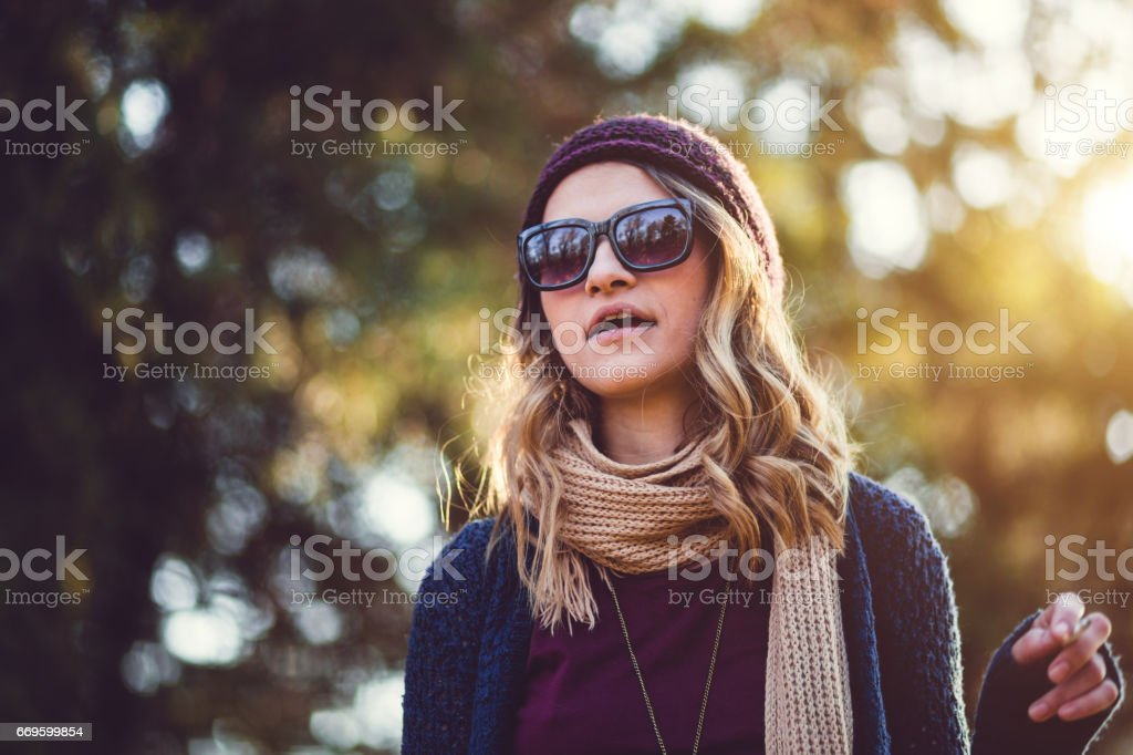 Portrait Of Smoker Girl On Sunny Day stock photo