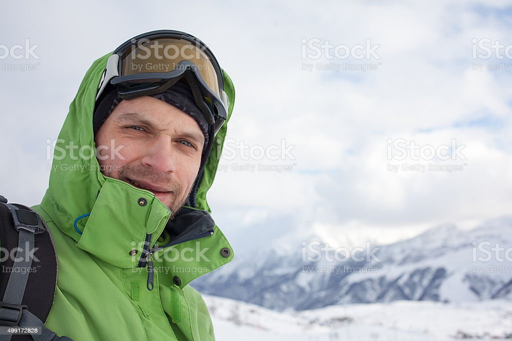 Portrait of snowboarder in high winter mountains in Gudauri, Geo stock photo