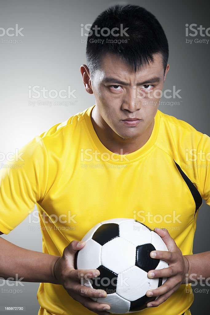 Portrait of soccer player holding a ball royalty-free stock photo