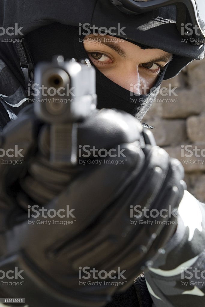 Portrait of soldier targeting with pistol royalty-free stock photo
