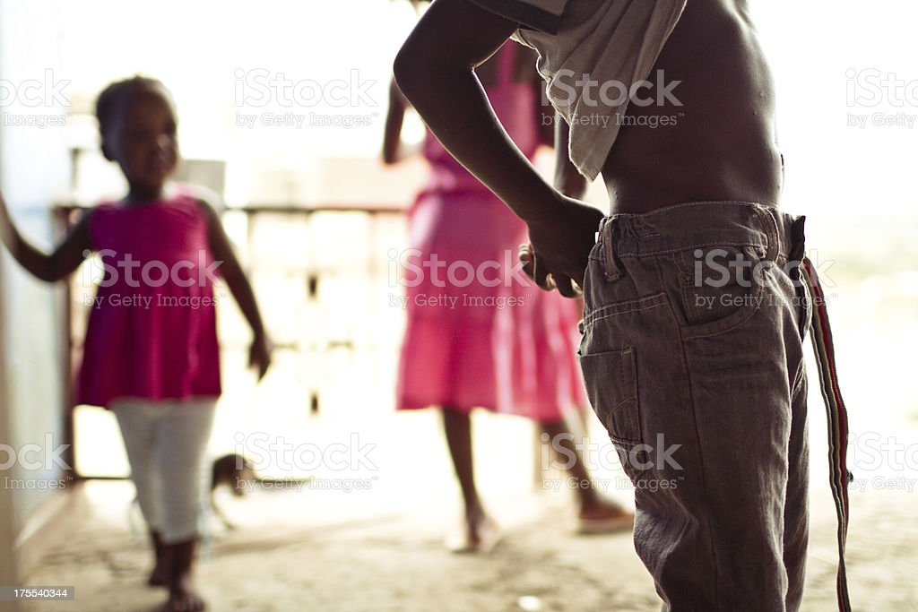 Portrait of South African first grader putting on his belt royalty-free stock photo