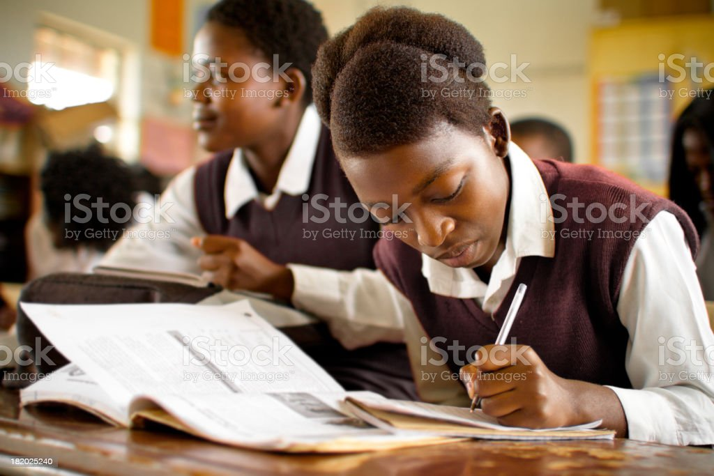 Portrait of South African girls studying in a rural classroom royalty-free stock photo