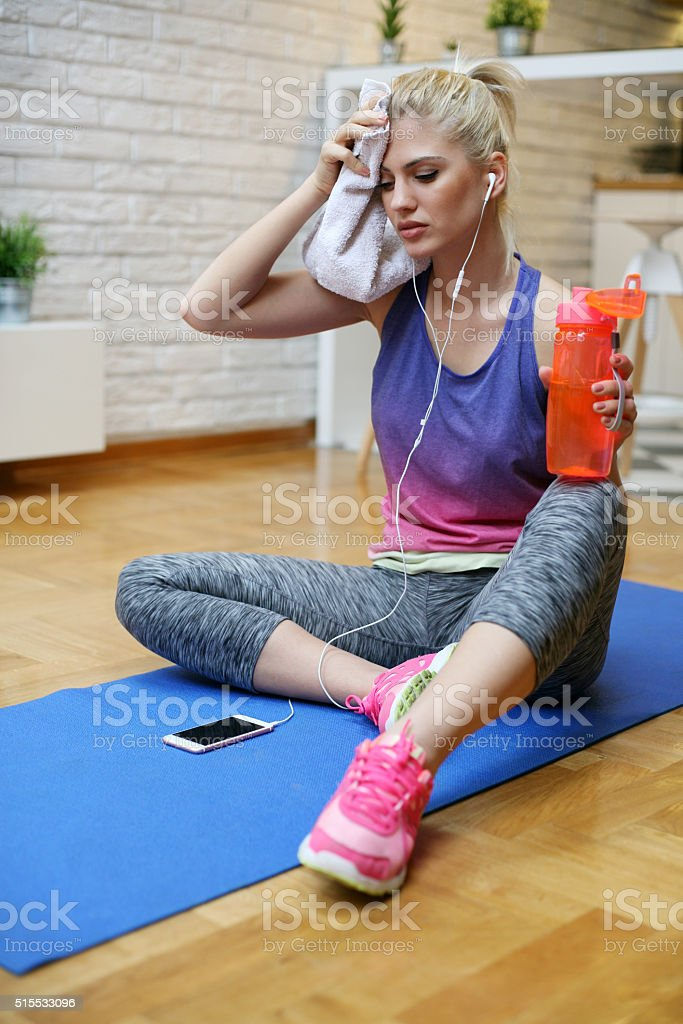 Portrait of sporty woman look tired after workout. stock photo