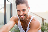 Portrait of sporty young man smiling in backyard