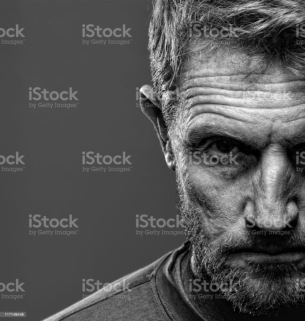 Portrait of stern bearded man stock photo