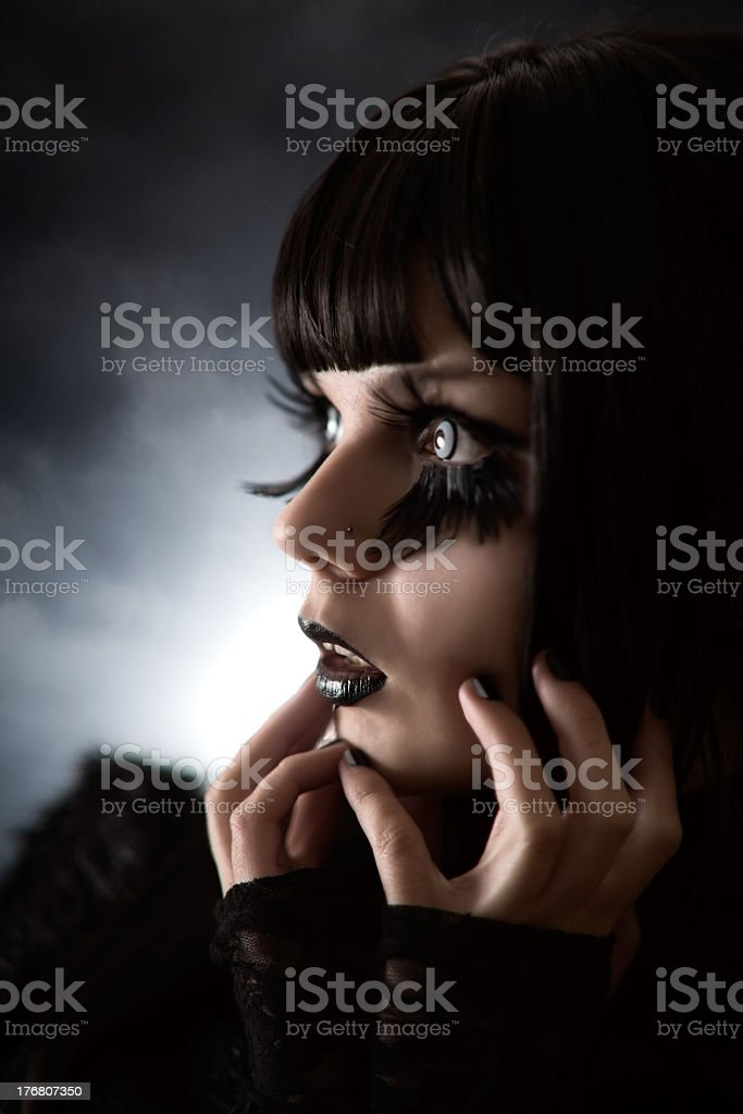 Portrait of strange girl with creative make-up and artificial eyelashes royalty-free stock photo