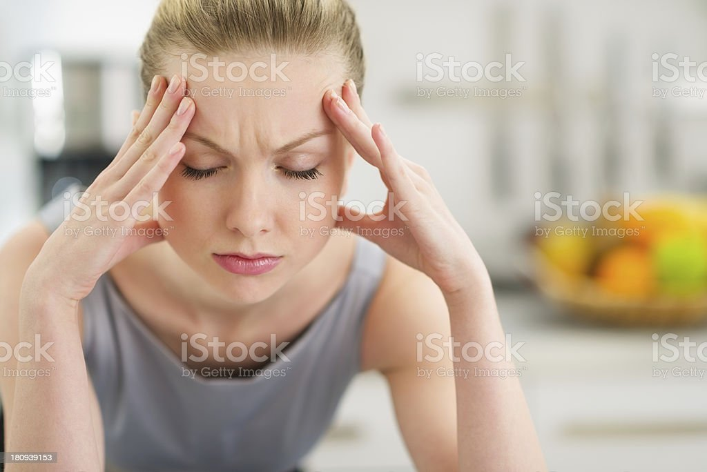 Portrait of stressed young housewife in modern kitchen stock photo