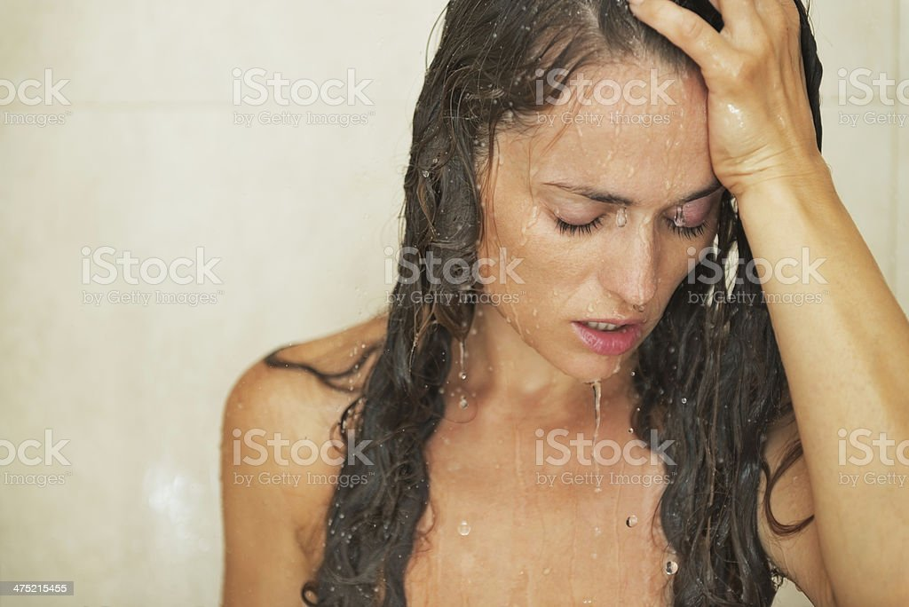 portrait of stressed young woman in shower royalty-free stock photo