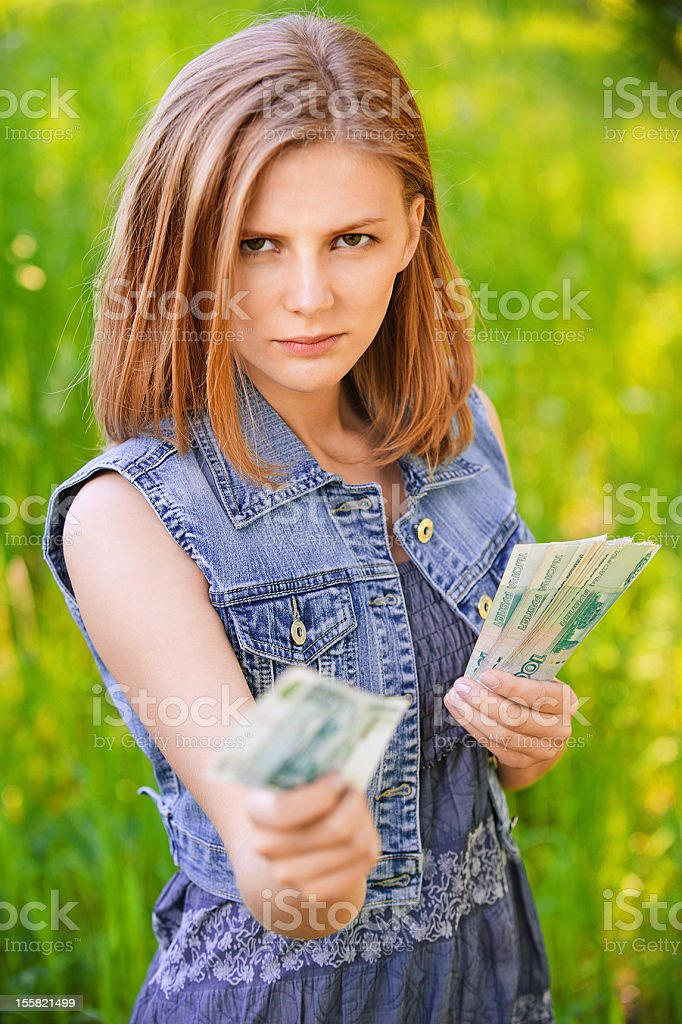 portrait of strict woman with money royalty-free stock photo