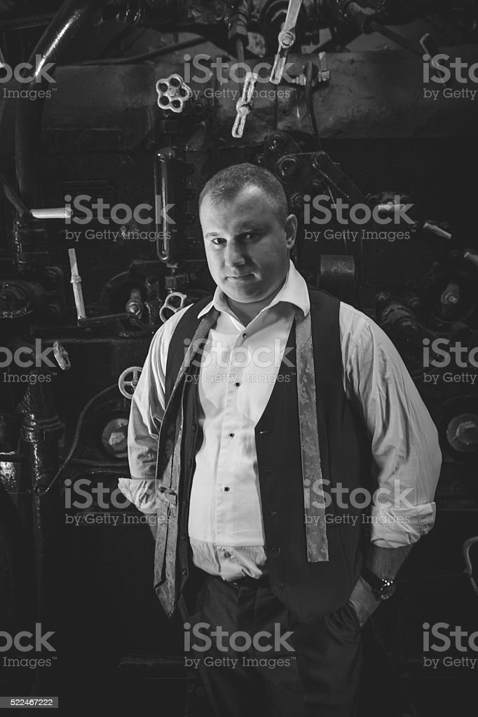portrait of stylish man in retro suit at furnace stock photo