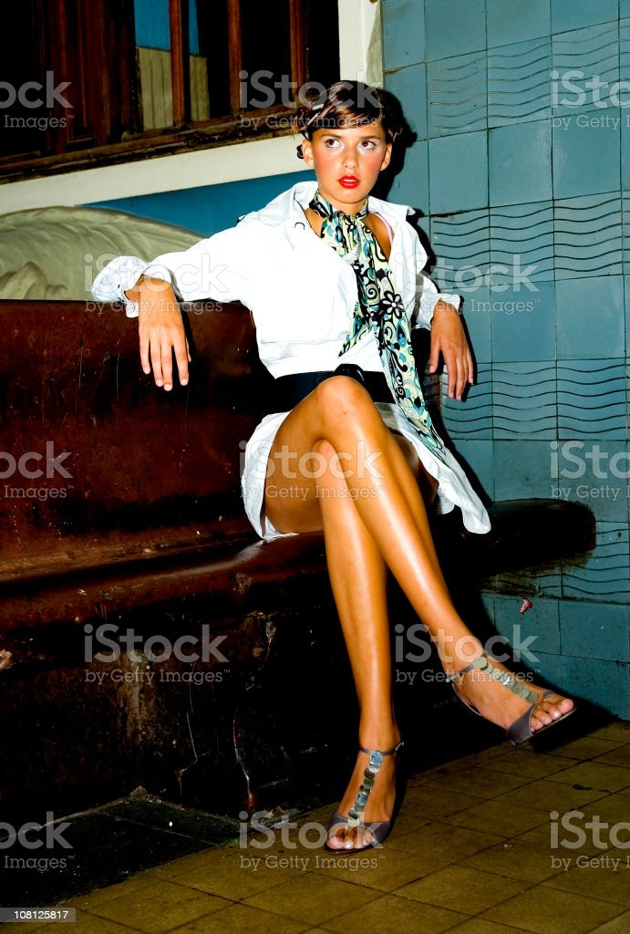 Portrait of Stylish Young Woman on Bench royalty-free stock photo