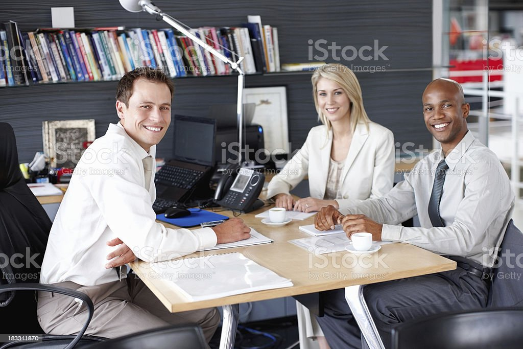 Portrait of successful business team smiling during a meeting royalty-free stock photo