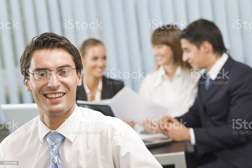 Portrait of successful businessman and business team at office meeting royalty-free stock photo