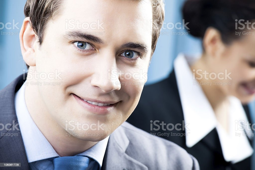 Portrait of successful businessman and colleague on background, at office royalty-free stock photo