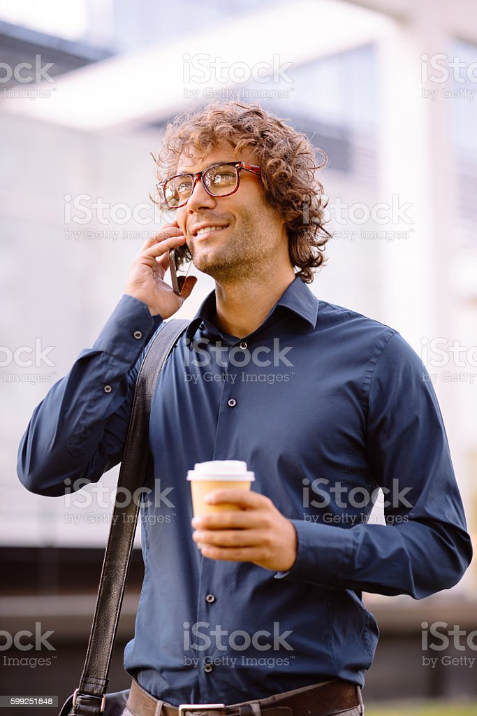 Portrait of successful businessman with smartphone stock photo