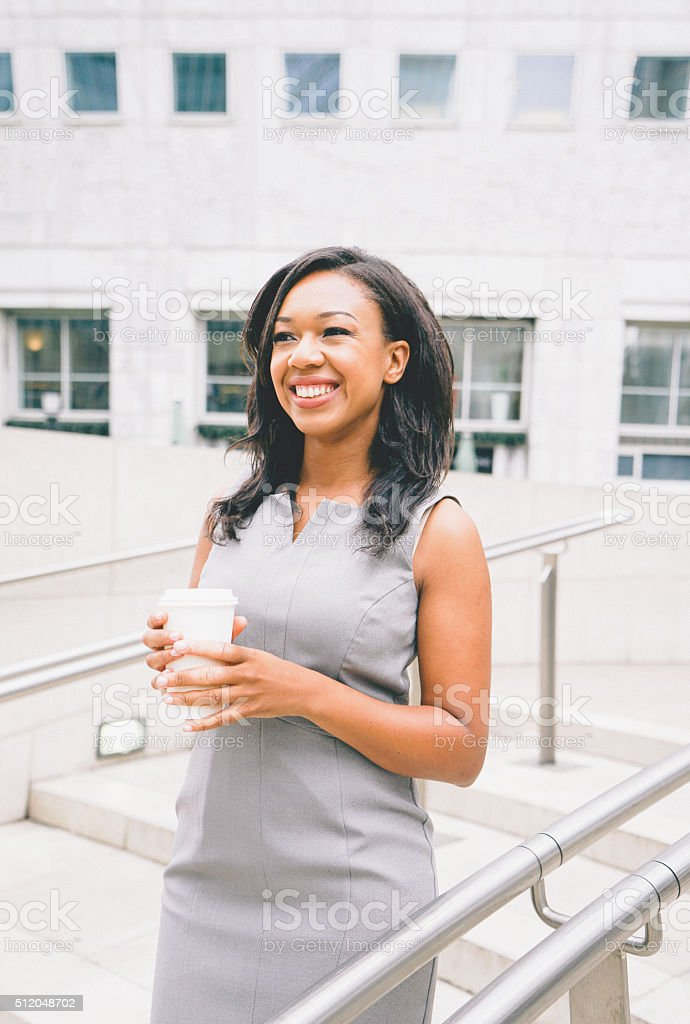 Portrait Of Successful Businesswoman Drinking Coffee stock photo
