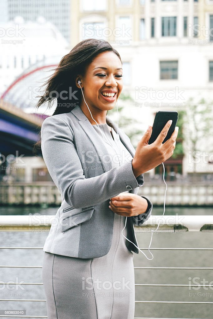 Portrait Of Successful Businesswoman Using Smartphone Outdoors stock photo