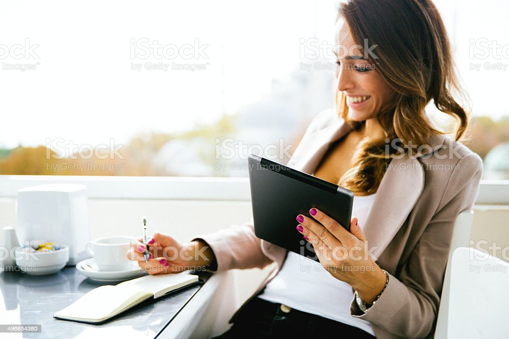 Portrait Of Successful Businesswoman Working  At Cafè stock photo