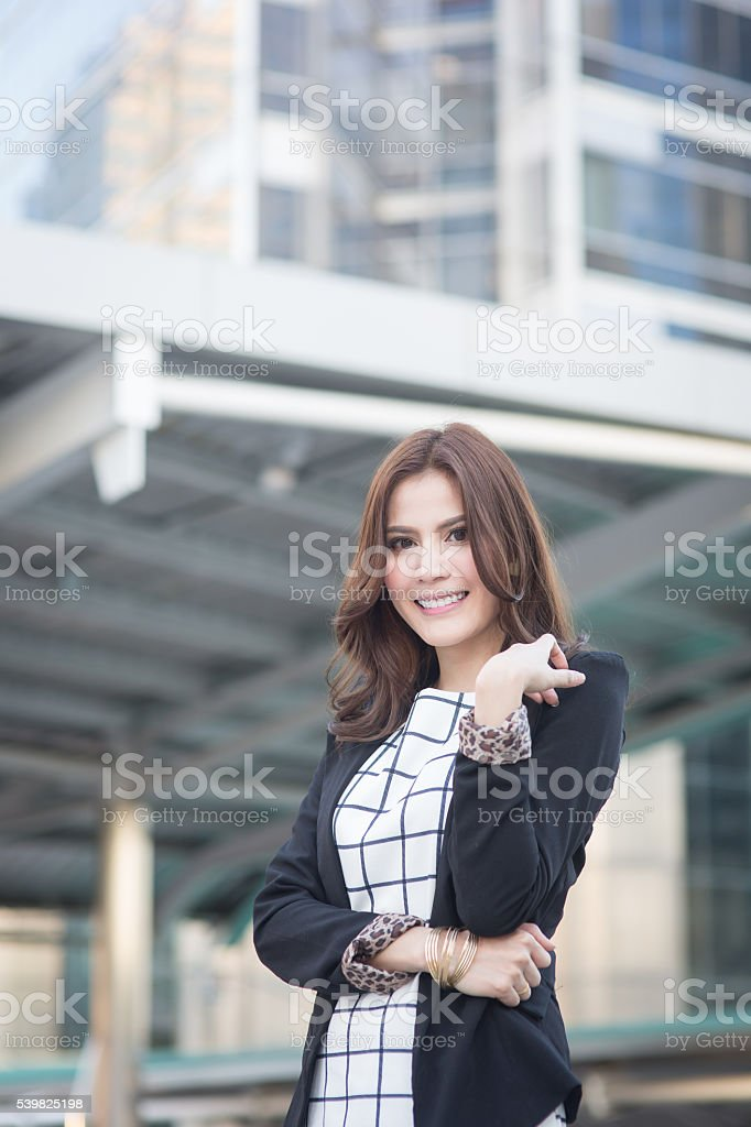 Portrait of successful smart business woman looking confident and smiling stock photo
