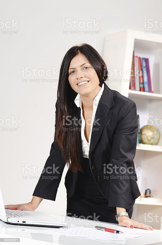 Portrait of successful young businesswoman CEO in office stock photo