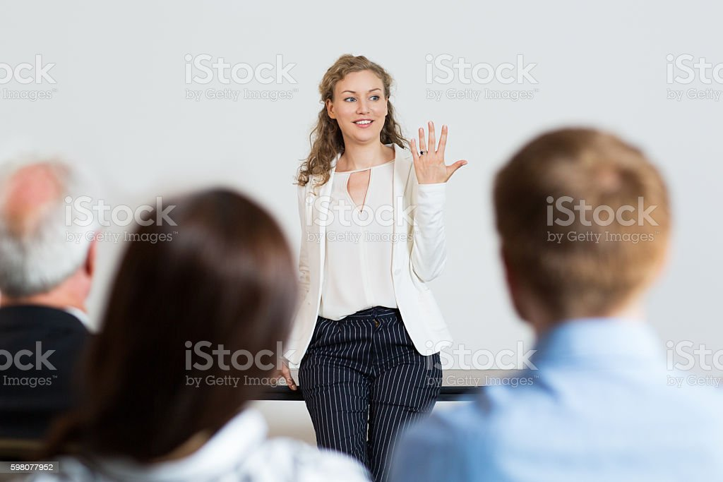 Portrait of Successful Young Businesswoman Explaining Ideas to T stock photo