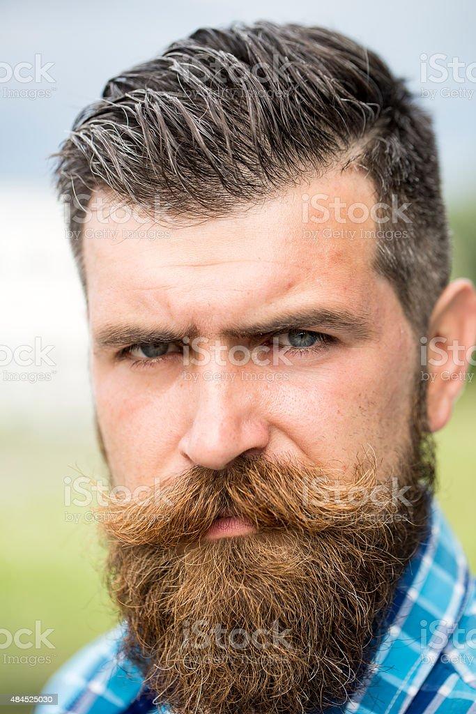Portrait of sullen man outdoor stock photo