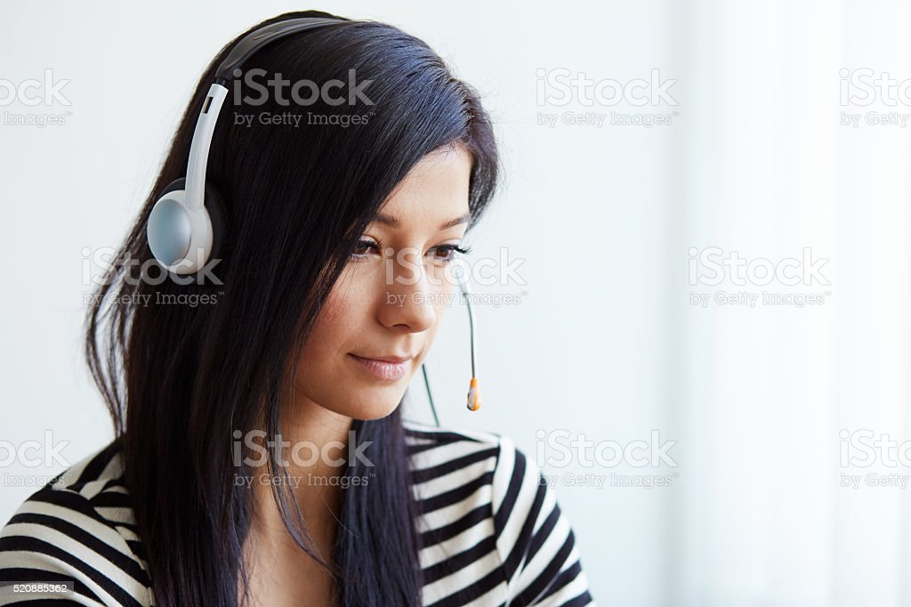 Portrait of support female phone operator stock photo