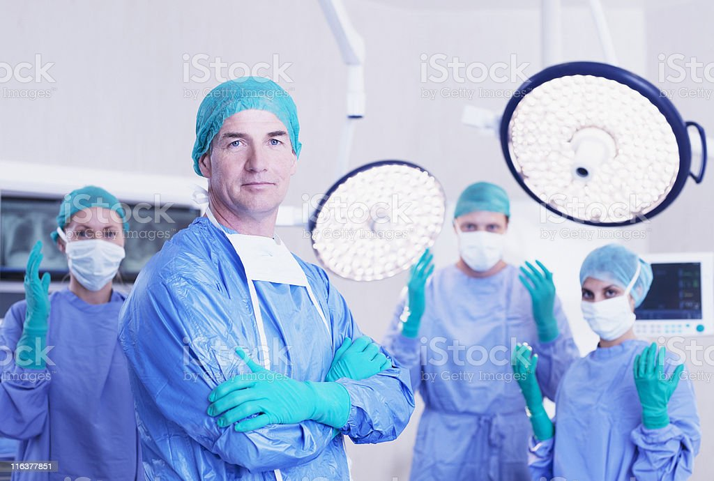 Portrait of surgeons in operating room royalty-free stock photo