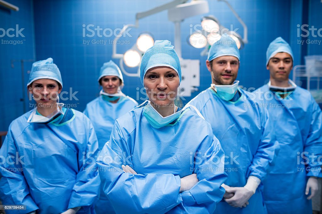 Portrait of surgeons standing in operation room stock photo
