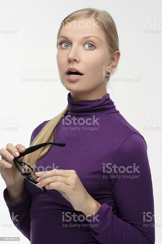 Portrait of surprised  young woman wearing glasses royalty-free stock photo