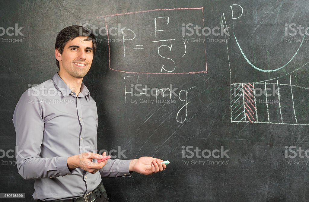 Portrait of teacher man near chalkboard with mathematical formulas stock photo