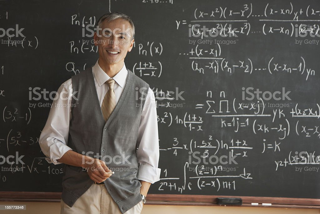 Portrait of teacher with in front of blackboard stock photo