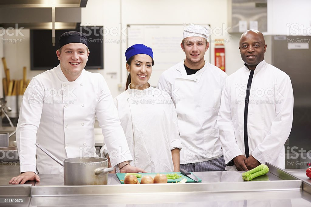 Portrait Of Teacher With Students In College Catering Class stock photo