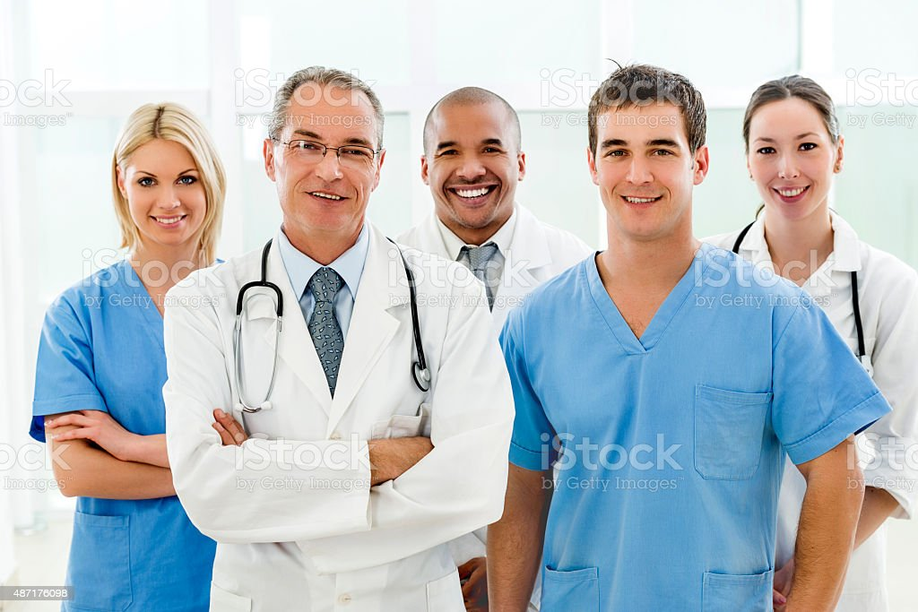 Portrait of team of doctors looking at camera. stock photo