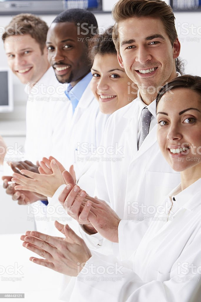 Portrait Of Technician And Colleagues In Laboratory Clapping royalty-free stock photo