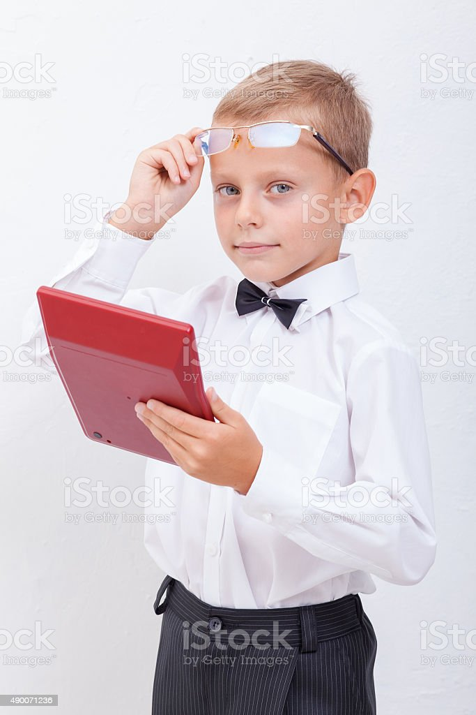 Portrait of teen boy with calculator on white background stock photo