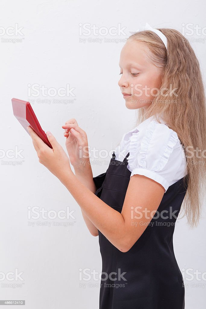 Portrait of teen girl with calculator on white background stock photo