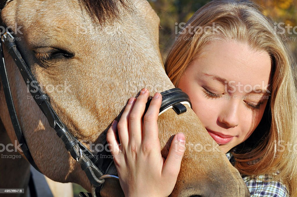 portrait of teenage girl and horse stock photo