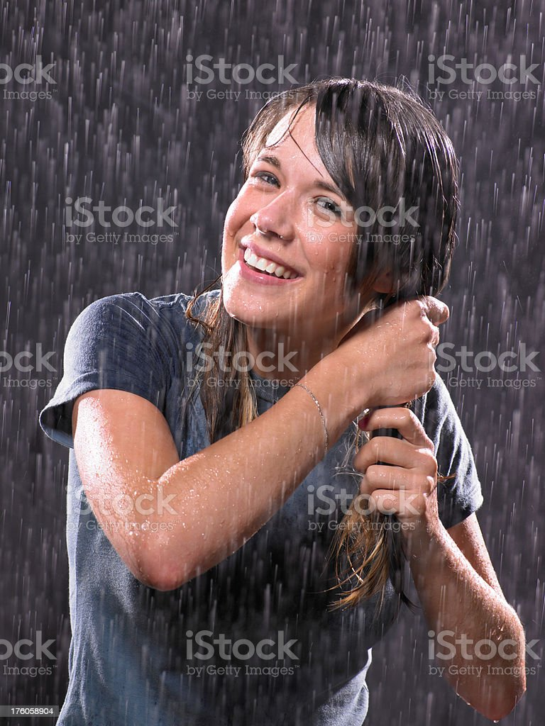 Portrait of teenage girl in the rain stock photo