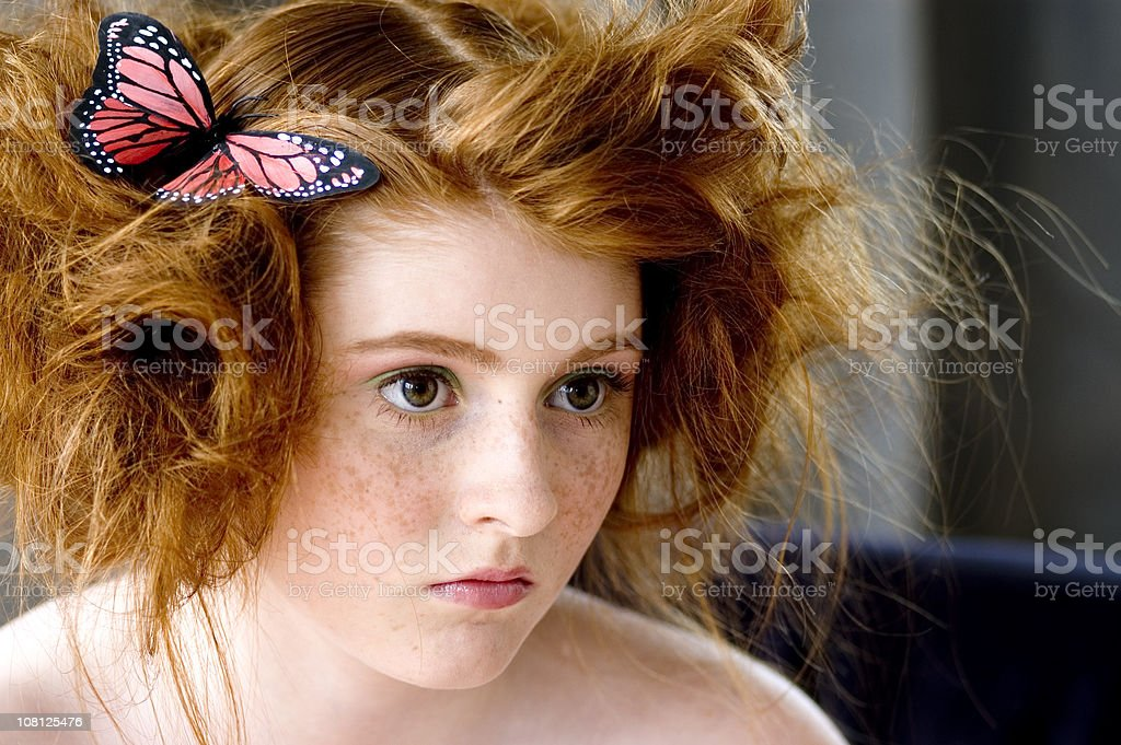 Portrait of Teenage Girl with Butterfly in Hair royalty-free stock photo