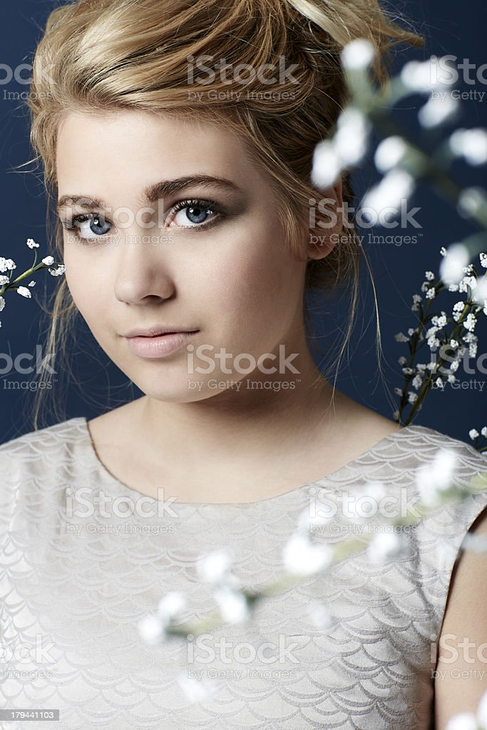 Portrait of teenage girl with flowers royalty-free stock photo