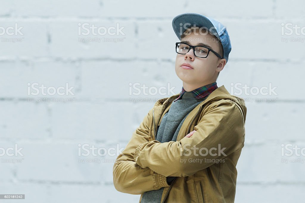 Portrait of teenage wearing cotton blue baseball cap stock photo