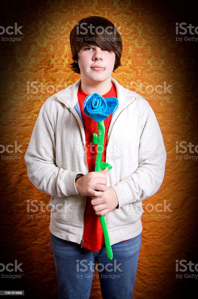 Portrait of Teenager Holding Large Velvet Flower royalty-free stock photo