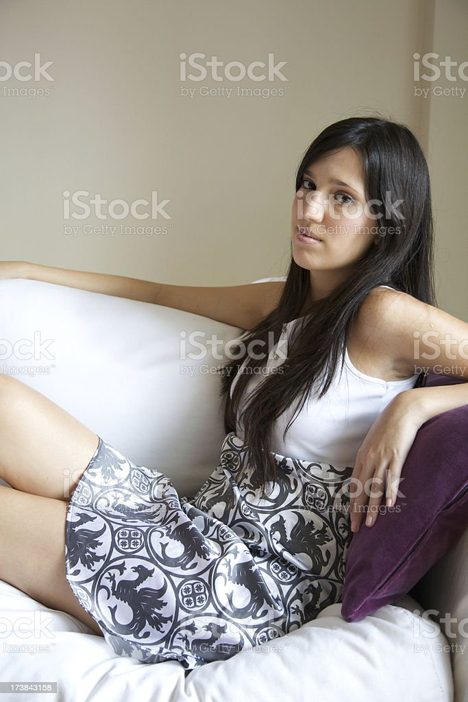 Portrait of teenager sitting in a couch stock photo