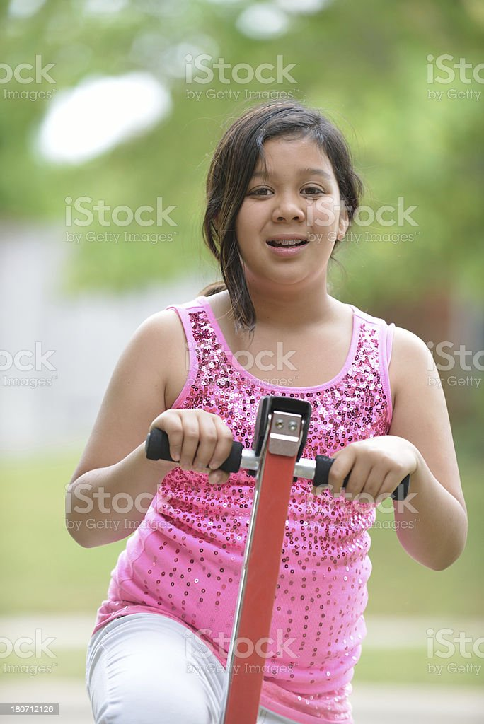 Portrait of ten year old girl with pink top outdoors stock photo