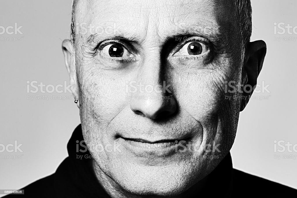 Portrait of tense, staring mature man in monochrome stock photo