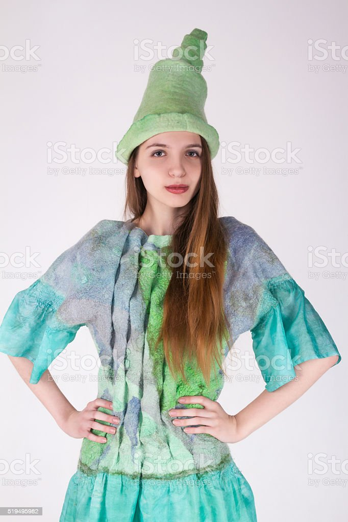 portrait of the beautiful charming girl in a turquoise suit stock photo